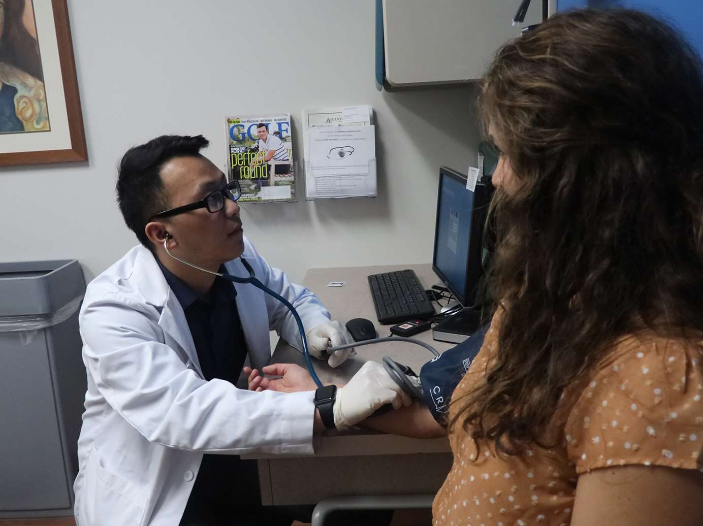 Pharmacy and medical students work together to provide care at Saturday Clinic for the Uninsured