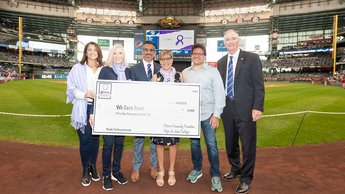 We Care Fund check presentation at Miller Park on September 8, 2019