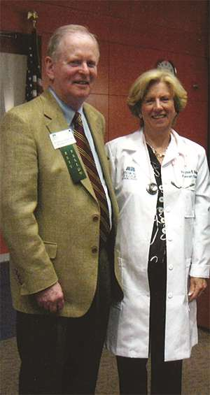 Ginny Bolger receives honorary white coat at alumni banquet in 2010