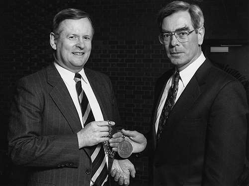 Mike Bolger congratulates Dr. Michael Dunn upon his installation as MCW Dean in 1995