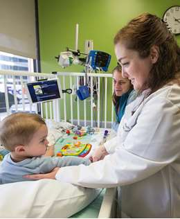 One-year-old Atlas Faucher was diagnosed with Pompe disease, a rare genetic disorder, when he was three months old. His mother, Genevieve, and Dr. Gabrielle Geddes discuss how Atlas is doing during an enzyme infusion treatment at Children's Hospital of Wisconsin