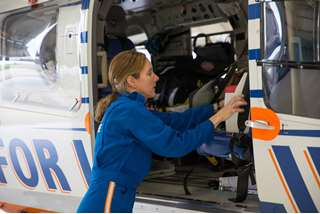Linda Owens, flight nurse, preps helicopter for air medical services