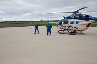 Flight For Life crew members prepare for takeoff from the Waukesha base