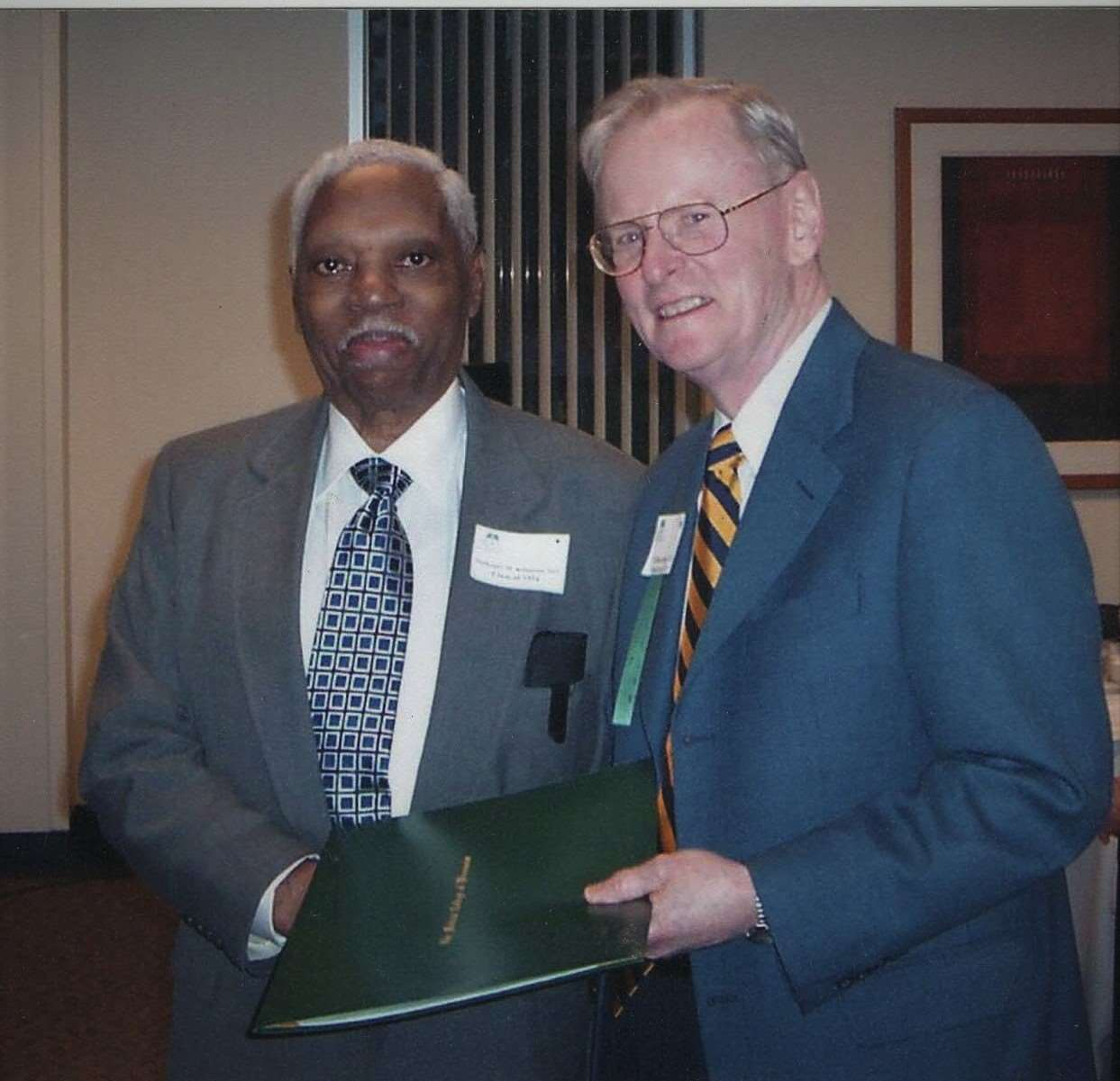 Dr. Nathaniel Robinson and  T. Michael Bolger, JD