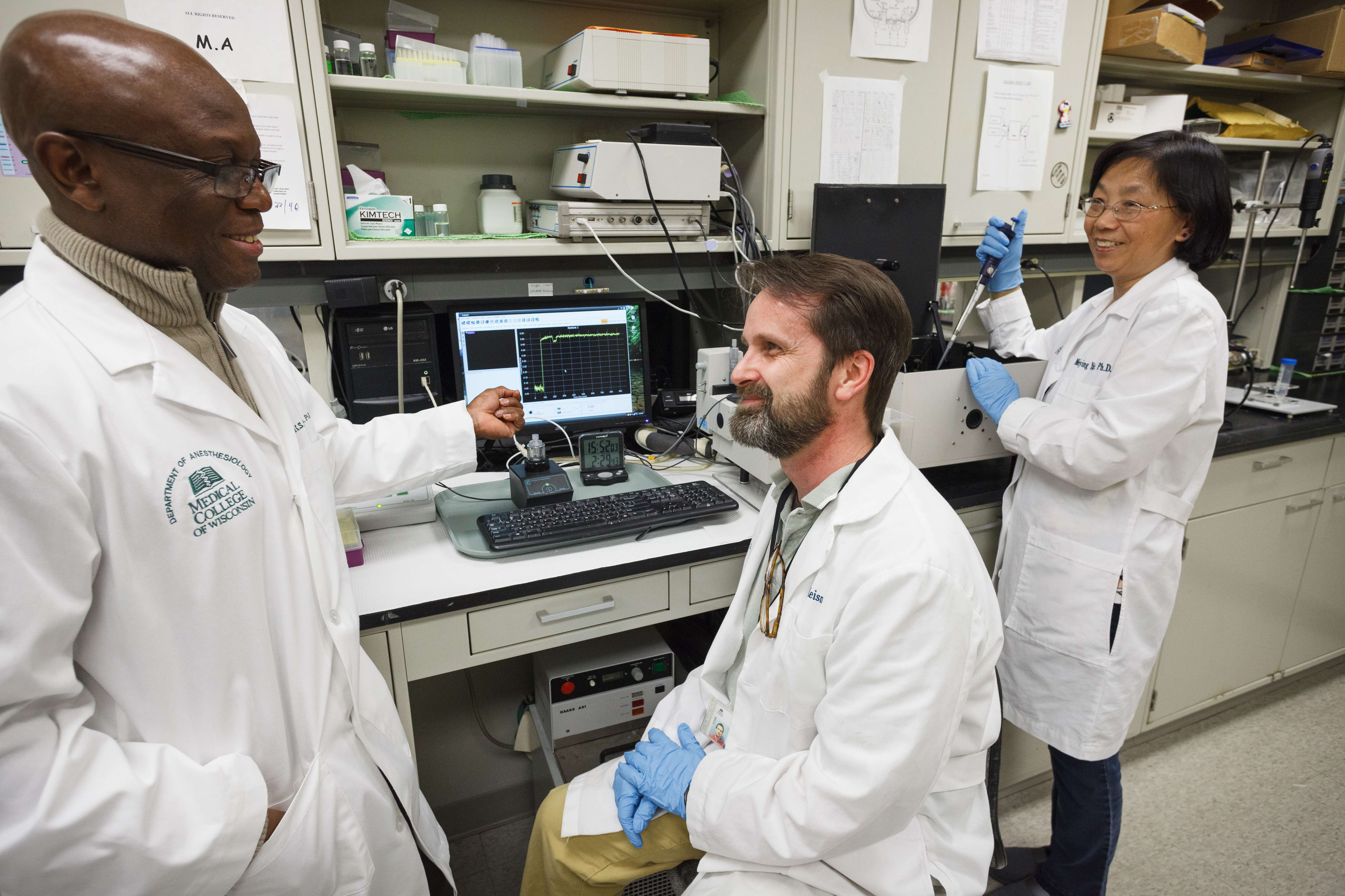 Four researchers in the lab