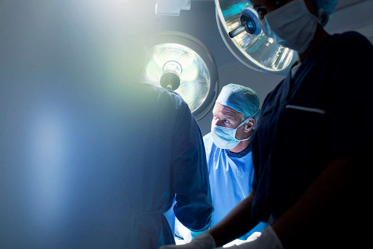 Surgeon in operating room backlighting