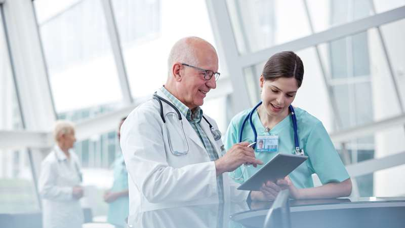 Doctors Consulting around Tablet